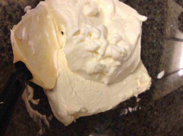 Preheat oven to 350. Grease a 13x9-in baking dish. Mix together cream cheese and...