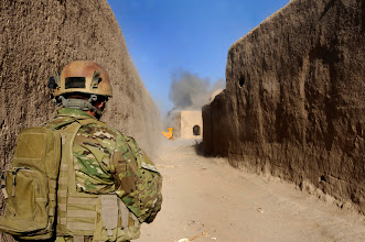 Photo: An United States Special Forces (USSF) soldier watches as a wall is breached to fit their vehicles in a compound that seized in Hyderbad, Helmand Province, Afghanistan, on Oct. 11.  It was part of Operation Riverdance.  The goal was to set up and establish a site to host Village Stability Operations (VSO).  In hopes to help local Afghans in Hyderbad defend themselves against the Taliban.  (U.S. Air Force photo by Staff Sgt. Rasheen A. Douglas/Released)