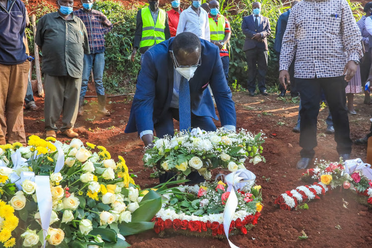 Kiambu Governor James Nyoro lays a wreath at the grave of the Muguga MCA, who died of Covid-19