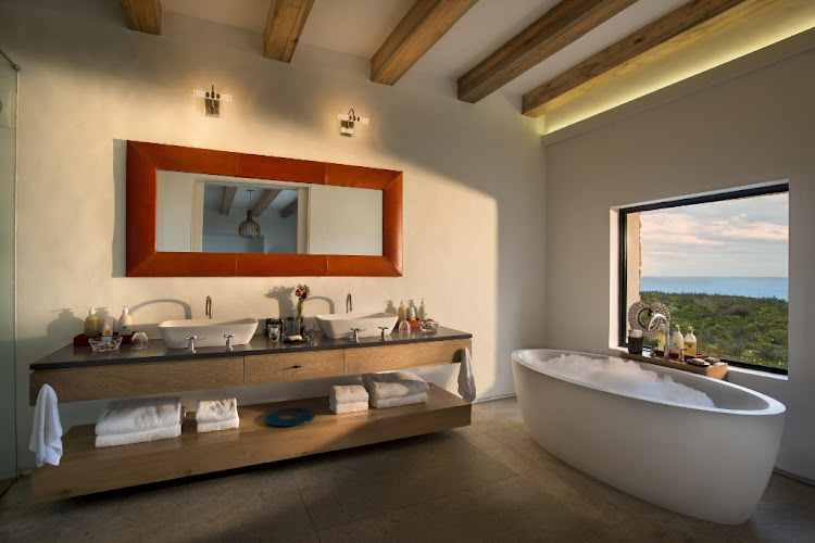 Morukuru Ocean House's bathroom with a view.