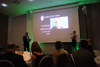 "Photo: Maxim Behar and Lena Brandt announcing the category ""Media of the Future"""