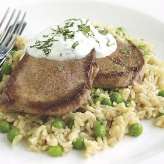 Steaks with Pea Pilaf and Yogurt Sauce