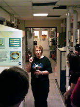 Photo: NASA employee explains thin film technology