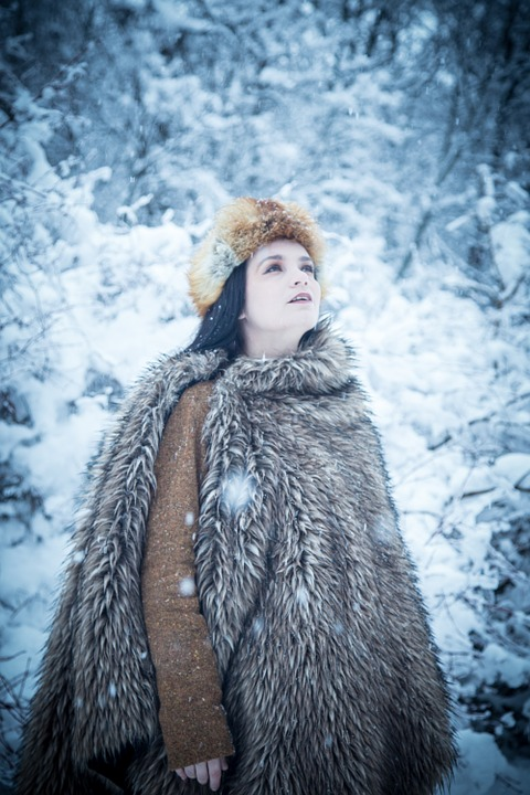 woman in fur style coat in snow