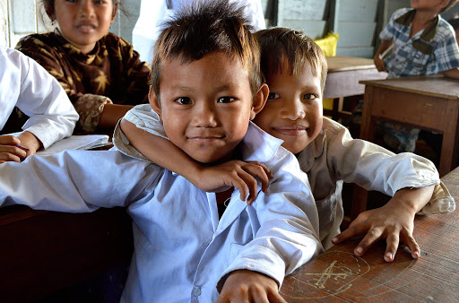 cambodia-schoolboy-friends.jpg - Cambodian schoolboys in a floating school along the Mekong River.