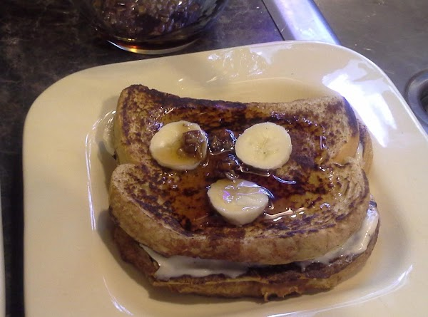 place your Stuffed French Toast on plates, top with banana slices and drizzle with...
