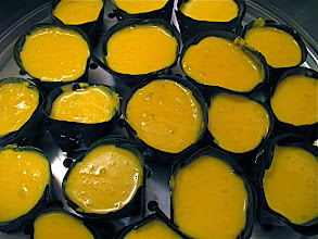 Photo: banana-leaf cups filled with pumpkin batter