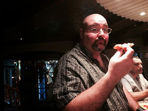 Photo: Dave went to the Lido Deck and brought a pizza back for all of us enjoying last call at the piano bar.