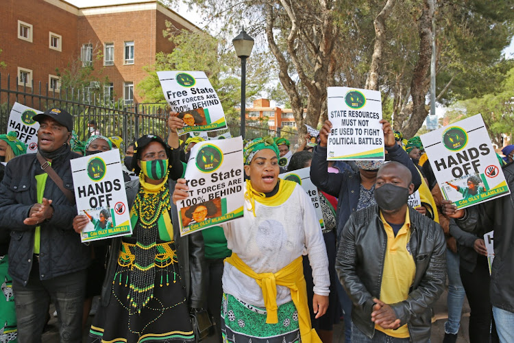 Sarah Mlamleli's supporters chanted struggle songs outside court in Bloemfontein where the former mayor is appearing with six other people in connection with alleged tender fraud.