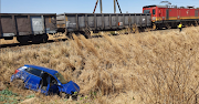 A vehicle which broke down on train tracks in KwaZulu Natal was badly damaged, but its owner escaped unharmed.