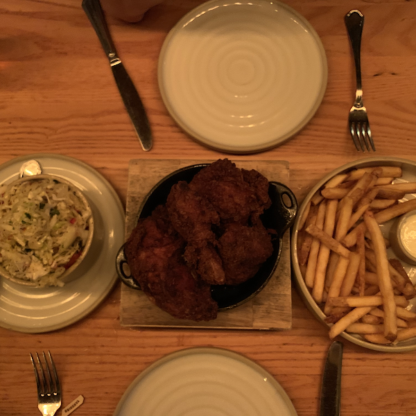 Coleslaw, fried chicken and french fries.
