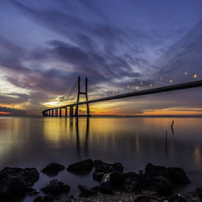 Vasco da Gama Bridge by Alexandre Mestre - Buildings & Architecture Bridges & Suspended Structures ( sunrise, lisbon, portugal, clouds, water, orange, cloud, cloudy, vasco da gama, sunset, bridge, river, landmark, landscape )