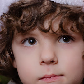 Contemplation by Chris Cavallo - Babies & Children Child Portraits ( curly hair, hat, brown eyes, boy )