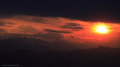 Photo: Mount Fuji through broken clouds