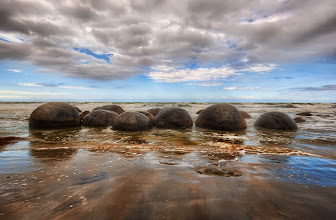 Photo: The Mysterious Moeraki Boulders  When I saw these strange round rocks for the first time, I was extra-fascinated. Not that I had any idea what they were. My years of geology training did me no good at all... I think it was even more frustrating because I knew all the things they could not be. The remaining possibilities just seemed off-the-chart impossible.   from the blog www.stuckincustoms.com