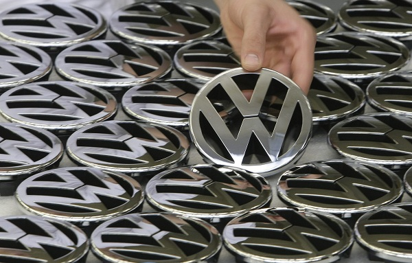 An employee holds an emblem for a Volkswagen Golf car in a production line at the Volkswagen headquarters in Wolfsburg, Germany, in this November 14 2008 file photo. Picture: REUTERS