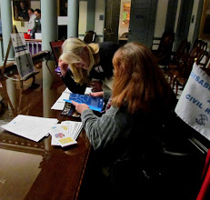Photo: Daniese McMullin Powell peruses the ADA literature available on display during Disability Day at Legislative Hall in Dover on 3.25.15.