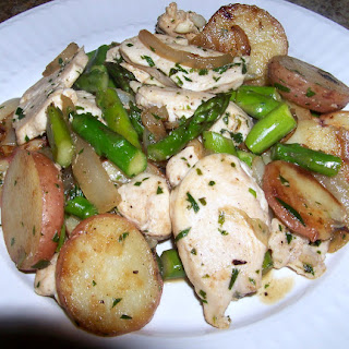 Spring Chicken Breast Braise with Potatoes and Asparagus.