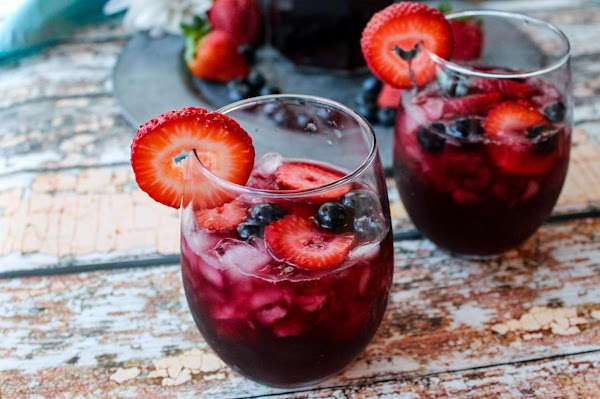 Two glasses of blueberry hibiscus sangria.