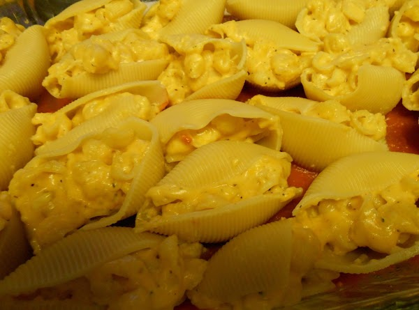 Spoon cheese-shell mixture into drained jumbo shells; place stuffed shells in prepared baking dish....