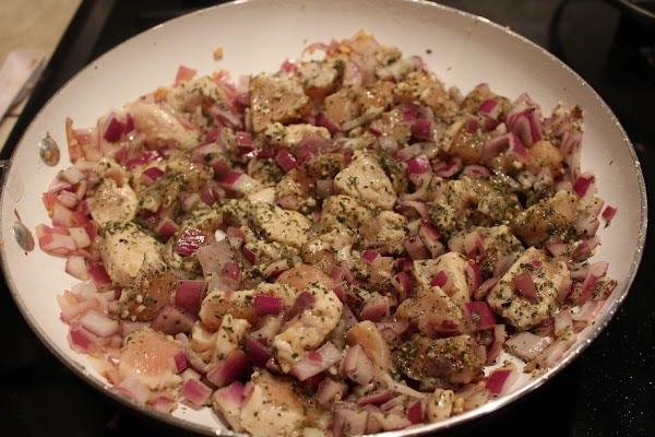 Using a wok or a large sautee pan add the olive oil to the...