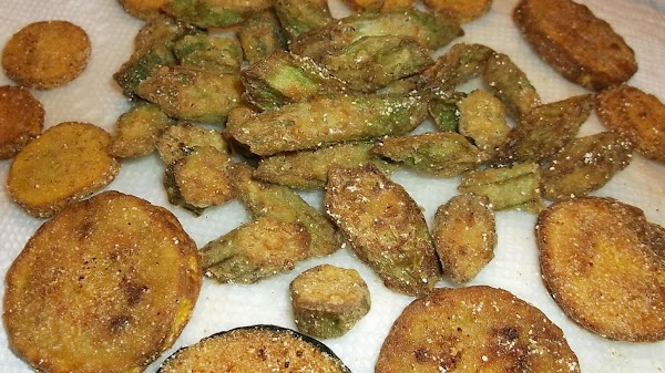 Remove to paper towels as desired browning is achieved. Continue adding okra to hot...