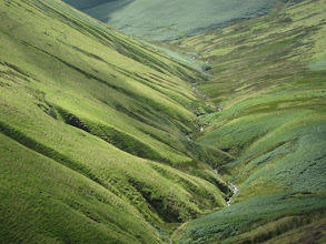 Photo: Its tributaries have carved gashes in the valley.