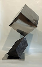 Photo: BALANCING ACT 4 - CUBE ON RHOMBOHEDRON - 24H X 16W X 12D, Lost Foam Iron Casting with Hematite surface, Polished Mild Steel, Interactive Kinetic, Front View