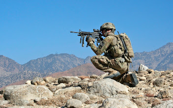 Photo: LAGHMAN PROVINCE, Afghanistan – U.S. Army Capt. Jason Merchant, the Company A, 1st Battalion, 133rd Infantry Regiment commander from  Dysart, Iowa, scans the area while on patrol on a mountainside near the village of Sigin Jan. 1. The Soldiers discovered a command wire in a riverbed while on patrol and called in the 744th Ordnance Company's explosive ordnance disposal team to try and locate an improvised explosive device, however, none were found. The area, near the Watangatu boys' school, has been an IED hotbed. (Photo by U.S. Army Staff Sgt. Ryan C. Matson, Task Force Red Bulls Public Affairs)