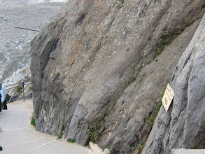 Photo: Signs mark the level of the glacier in years past -- in 1980 the glacier top was here.