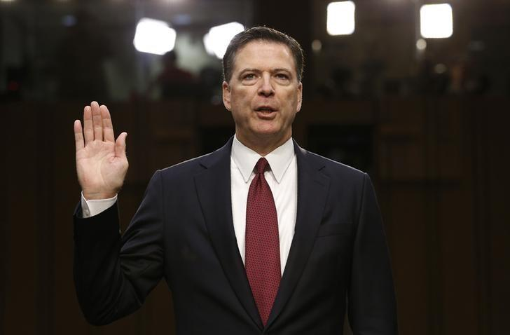 Former FBI Director James Comey is sworn in prior to testifying before a Senate Intelligence Committee hearing on Russia's alleged interference in the 2016 U.S. presidential election. Picture: REUTERS