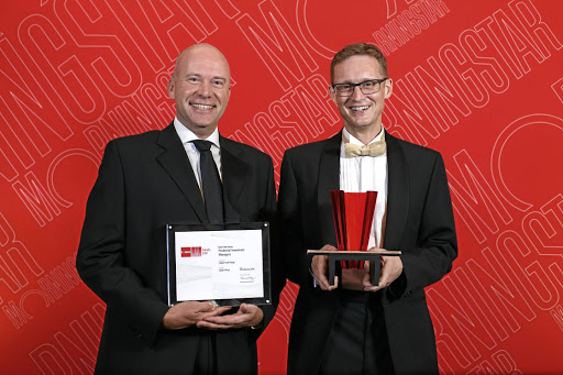 Bernard Fick, CEO, and David Knee, chief investment officer, at Prudential Investment Managers accept the Morningstar Award for the Best Fund House Larger Range at the awards ceremony in Cape Town this week. Picture: SUPPLIED
