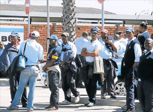 Algoa bus company employees mill around the Pearl Road depot during strike action in April.