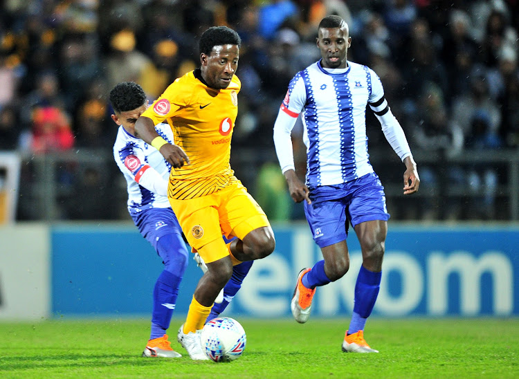 Siphelele Ntshangase (C) of Kaizer Chiefs gets away from a challenge by Keagan Buchanan (L) and Siyanda Xulu (R) of Maritzburg United during the Absa Premiership match at Harry Gwala Stadium, Pietermaritzburg on August 17 2018. The match ended 0-0.