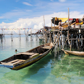 by Alvin Ngow - Buildings & Architecture Bridges & Suspended Structures ( moods, landscape, fishing village, people, water house, photography, island, sabah, borneo, child, clear, life, blue sky, sky, village, nature, poverty, transport, semporna, swim, asia, gypsies, bajau laut, travel locations, water, houses, clothes, drying, sea, tourism, malaysia, seascape, boat, relaxing, waterscapes, fishing boat, human, holiday, fishermen, wooden, blue, sampan, background, outdoor, sea gypsy, island hopping, bridge, landscapes,  )