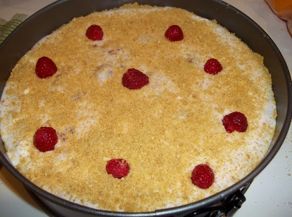Fold in whipped cream, raspberries and pecans. Pour into prepared crust. Top with remaining...
