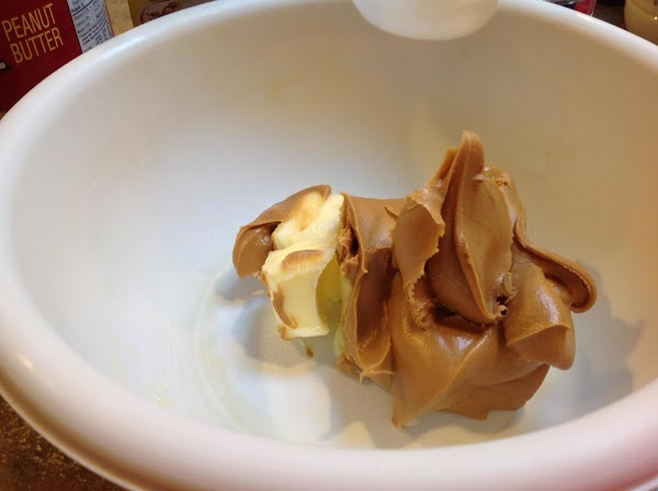 Add the softened butter and peanut butter to a medium size bowl and beat...