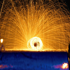 Revolving Sparks by Nick Ericson - Abstract Fire & Fireworks ( ring, night, blur, amateur, long exposure, travel photography, blue, light, beginner, beach, thailand, fire, travel, lights )