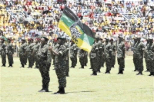 QUIT CALL: MK veterans at a parade. Chairperson of their portfolio committee Nyami Booi has been called on to resign over theft. Pic: Sydney Seshibedi. 16/12/2008. © Sowetan. Members of the MK march during an ANC rally at Seisa Ramabodu Stadium in Mangaung Bloemfontein. Pic: SYDNEY SESHIBEDI 16/12/2008. © Sowetan.