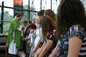 Photo: New missionaries receive the Sacrament.