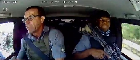 The driver asks his colleague to cock his rifle as bullets slam into the CIT vehicle. Screenshot.