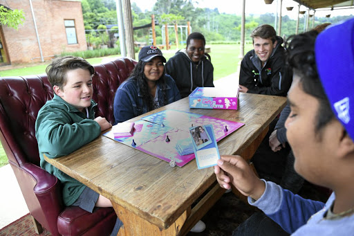 Teenagers Justin Campbell, Sarah-Leigh Bokwe, Sam Edgcumbe , Taro Reece, and Caleb Bokwe playing Viva Dating Game,  a  board game with a focus on  life skills. / JACKIE CLAUSEN