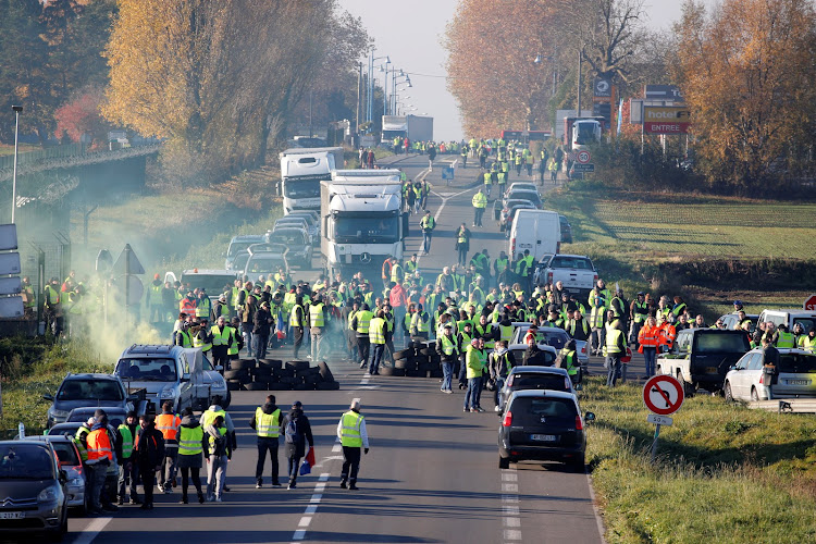 People wearing yellow vests, a symbol of a French drivers' nationwide protest against higher fuel prices, block the Paris-Brussels motorway in Haulchin, France, November 17, 2018.