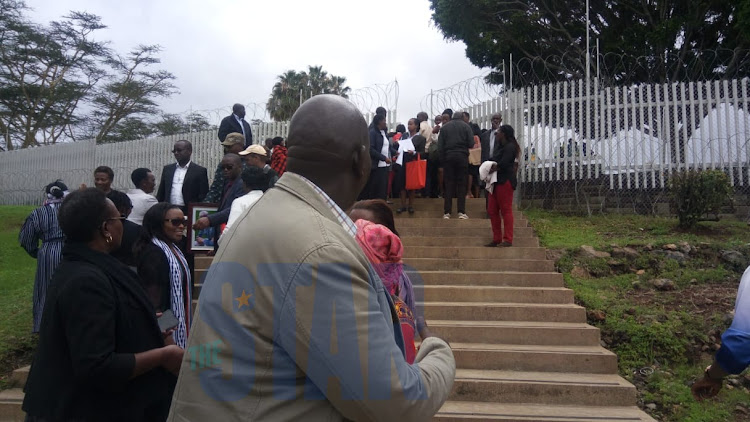 Family of the victims of the ET crash await the remains at JKIA.