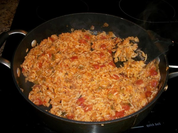Next: add can of crushed tomatoes, onion salt, garlic powder and tabasco (if using)...
