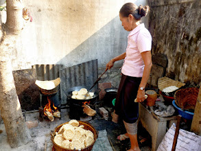 Photo: Sticky rice is a staple in Laos. It is formed in the shape of a disk, dried, and then cooked to be sold at the night market.