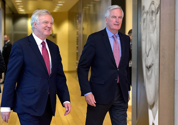 The European Union's chief  negotiator Michael Barnier (right) walks with Britain's Secretary of State for Exiting the European Union David Davis in Brussels, Belgium, on Monday. Picture: REUTERS