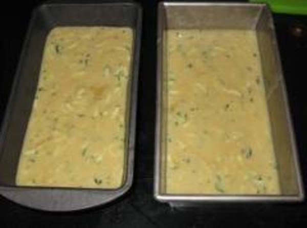 Divide the batter equally between two greased 5x9 inch loaf pans.  Bake for...