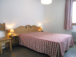 Photo: Une chambre double d'un appartement de la résidence
