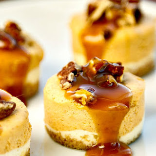 Mini Pumpkin Cheesecakes with Bourbon Pecan Caramel Sauce